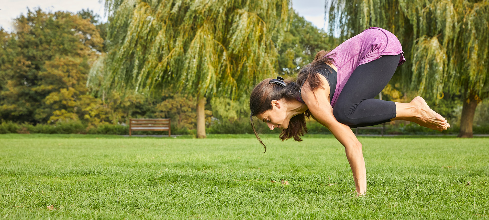Crow_pose_in_the_park